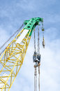 Industrial construction crane are operating over blue sky Stock Images