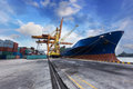 Industrial Container Cargo freight ship with working crane bridg Royalty Free Stock Photo