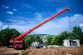 Industrial Crane operating and lifting an electric generator Royalty Free Stock Photo