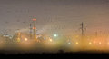 Industrial district by night near the city foggy over the field with thermal power plant in the background Royalty Free Stock Photography
