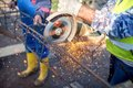 Industrial engineer working on cutting a metal and steel bar with angle grinder Royalty Free Stock Photo