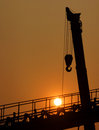 Industrial equipment under the setting sun Stock Photos
