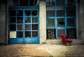 Industrial exterior with red chair Royalty Free Stock Image