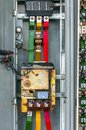 Industrial fuse box on the wall closeup photo Stock Photos