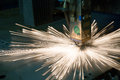 Industrial laser making holes in metal sheet Royalty Free Stock Photo