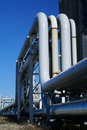 Industrial pipelines on pipe-bridge and blue sky Stock Image