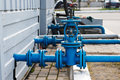 Industrial pipelines and valves two blue old Royalty Free Stock Photography