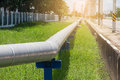 Industrial pipes of steam high pressure beside the road in indus Royalty Free Stock Photo