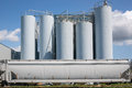 Industrial plant with silos against blue sky Stock Photography