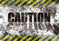 Industrial safety caution sign danger with black and yellow banner striping splattering and reflection on word Stock Photography
