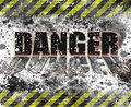 Industrial safety danger sign with black and yellow banner striping splattering and reflection on word Stock Images