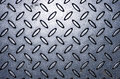 Industrial shiny metal silver list with rhombus shapes. Royalty Free Stock Photo