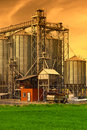 Industrial silos, sunset sky Royalty Free Stock Photo