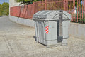 An industrial sized bin a large refuge at the side of the road Royalty Free Stock Photo