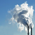 Industrial smoke from chimney on sky Royalty Free Stock Photo