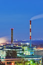 Industrial smoke stacks at night smoking chimneys Royalty Free Stock Images