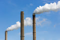 Industrial smoke stacks of a power plant. Royalty Free Stock Photo