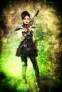 Industrial soldier portrait of a beautiful steampunk woman holding a gun over grunge background Stock Photography