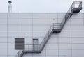 Industrial stairway on steel modern tile facade Royalty Free Stock Photo
