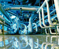 Industrial  Steel pipelines in blue tones with reflection Royalty Free Stock Photo