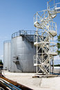 Industrial storage tanks with a latter access Stock Photo