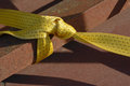 Industrial strap yellow for protection and security on metal Stock Photo