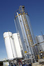 Industrial tanks outdoor big ontdoor over blue sky Stock Images