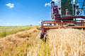 Industrial vintage harvesting machinery in wheat crops rural agriculture and farming with machines Stock Photo