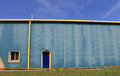 Industrial warehouse building exterior of in blue and yellow Stock Photo