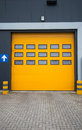 Industrial warehouse picture of yellow door in Royalty Free Stock Photography