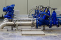 Industrial water pumping station with booster pumps and valves Stock Photography