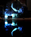 Industrial welding mirrored on the work table Royalty Free Stock Photos