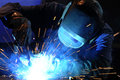 Industrial welding worker while doing a with arc welder Royalty Free Stock Photography