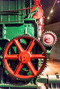 Industrial wheel gear in old paper machine Stock Images