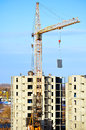 Industrial work at building site - lifting of  concrete slab by tower crane.  View from height. Royalty Free Stock Photo