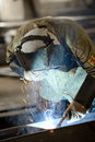 Industrial worker heavy industry in action stock photo Stock Photo