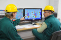 Industrial workers in control room Stock Photo