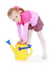 Industrious little girl with garden watering can