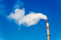 Industry chimney with exhaust gases of an industrial company smoke symbolic photo for environmental protection and ozone Royalty Free Stock Photo