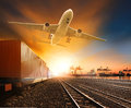 Industry container trainst running on railways track plane cargo Royalty Free Stock Photo