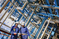 Industry workers inside oil and gas refinery Royalty Free Stock Photo