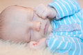 Infant asleep quietly sleeping on his side Royalty Free Stock Photo