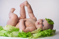 Infant baby is found in cabbage Stock Images