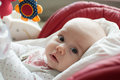 Infant baby girl in children chair playing with toy Royalty Free Stock Photo
