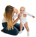 Infant baby girl learning to stand Royalty Free Stock Photo