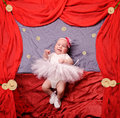 Infant baby girl wearing white ballerina tutu and crocheted ballet slippers Royalty Free Stock Photo