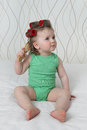 Infant baby with with hair curlers and hairbrush Royalty Free Stock Photo
