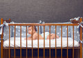 Infant baby laying in decorated cot Royalty Free Stock Photo