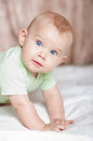 Infant baby playing at home on the bed Royalty Free Stock Image
