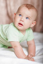 Infant baby playing at home on the bed Royalty Free Stock Photography